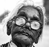 Face of a courageous Lady! Jabbalpur India (senguptapulak) Tags: old lady wrinkles face black white glass glasses