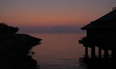 the first light, the first dawn... (hugo poon - one day in my life) Tags: xt20 23mmf2 hongkong lantauisland disneyland hongkongdisneylandhotel dawn colours light chinesenewyear yearofthedog haze pier victoriaharbour quietness sunrise