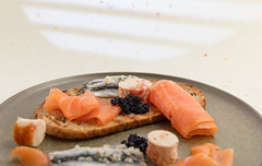 Salmon, anchovy, sturgeon eggs, fish terrine and grilled bread. (annick vanderschelden) Tags: smoked salmon slices golden decorative surface fish food smokedsalmon vinegar salmosalar protein bread roasted light anchovy garlic eggs sturgeon terrine cod whiting mullet