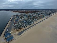 Clouds hover over Manasquan Beach. Captured by a DJI Phantom 4 drone. (apardavila) Tags: djiphantom4 jerseyshore manasquan manasquanbeach manasquanriver aerial beach beachfronthomes clouds drone sky