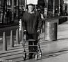 IMG_7678 (Akbar Simonse) Tags: denhaag thehague agga sgravenhage haag lahaye holland netherlands nederland people candid man rollator streetphotography straatfotografie zwartwit bw blancoynegro bn monochrome square vierkant akbarsimonse