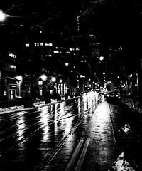 Toronto Noir (MassiveKontent) Tags: toronto noiretblanc blackwhite bw city monochrome urban blackandwhite streetphoto building streetphotography bwphotography streetshot night streetlights rain nightshot downtown