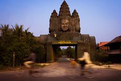 Majestic gate (Danique_b) Tags: fotodaniquevanderburg road temple buddha gate sun sky countryside golden hour tree architecture cambodia travel siem reap statue bike bicycle