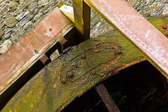 Metal, Stone, Wood & Slime (The_Kevster) Tags: leica rangefinder manx mann milntown isleofman ellanvannin summicron50mm leicam9 metal stone wood slime moss waterwheel iron victorian industry wheel watermill light