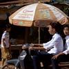 C Light (daniel_james) Tags: 2018 canon6d siemreap cambodia kambodscha grasshoppertours cycletour chreavvillage rural southeastasia villagemarket people square tamron90mmmacro umbrella advertising motorbike brown