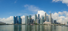 Singapore Skyline (Anthony Kernich Photo) Tags: singapore asia southeastasia seasia city cityscape downtown skyline buildings sky afternoon photo panorama urban olympusem10 olympus olympusomd microfourthirds travel marinabay day daytime cloud water stunning flickr