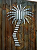 The Palm Tree (Steve Taylor (Photography)) Tags: palmtree art digital sculpture fence brown silver white steel newzealand nz southisland canterbury christchurch tree trunk leaves corrugated
