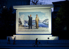 Kim il Sung and Kim Jong il on a propaganda mosaic fresco at night, Kangwon Province, Wonsan, North Korea (Eric Lafforgue) Tags: art artscultureandentertainment asia asianethnicity bicycle communism cultofpersonality dictators dictatorship dprk fresco horizontal humanbeing humanrepresentation illustration kangwonprovince kimilsung kimjongil koreanculture koreanscript night nkorea7467 northkorea northkorean patriotism politicians politicsandgovernment propaganda threepeople wonsan 北朝鮮 북한 朝鮮民主主義人民共和国 조선 coreadelnorte coréedunord coréiadonorte coreiadonorte 조선민주주의인민공화국 เกาหลีเหนือ קוריאההצפונית koreapółnocna koreautara kuzeykore nordkorea північнакорея севернакореја севернакорея severníkorea βόρειακορέα