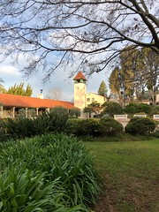 Morning Glow (Melinda Stuart) Tags: architecture tower clock garden landscape morning glow light sun early uc clarkkerr campus berkeley building shrubs tree tile roof mission spanish style shadow sky clouds explore