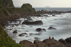 Fishing under the Cold Weather (miltonsun) Tags: fishing coldweather bitoujiaocoast 鼻頭角 newtaipeicity taiwan longexposure seascape bay ngc wave ocean shore seaside coast landscape outdoor clouds sky water rock mountain rollinghills sea sand beach cliff nature meadows sceniccoast northerncoast grass