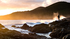 The lone fisherman (StefanKleynhans) Tags: sunrise coast fish fisherman waves rocks fishing spray colour color landscape ocean water sky orange warm light nikon d7100 forster nsw australia