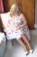 Coraflowdrsit-002 (fionaxxcd) Tags: crossdresser tranny trannie tv stiletto longblonde rednail necklace petticoat cleavage tights flowerydress