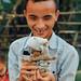 Disabled Boy With Doll, Luang Prabang Laos