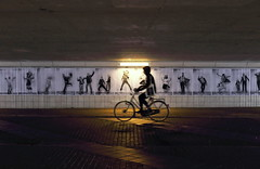The Passing (*Chris van Dolleweerd*) Tags: bicycle tunnel holland nederland movement urban architecture street streetphotography chrisvandolleweerd light lamp