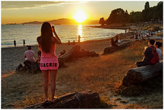Beachin' (HereInVancouver) Tags: sunset beach water ocean pacific youngwoman photographer beachin wordacrossbum vancouverswestend englishbay candid streetphotography city urban logs canong16 vancouver bc canada thingstodobythewater
