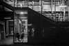 Up , down and across / one night in Hamburg (Özgür Gürgey) Tags: 2018 50mm bw d750 darkcity hamburg nikon rödingsmarkt evening grainy lights lines lowlight people reflection station street subway