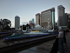 old heart of the city (SM Tham) Tags: asia southeastasia malaysia kualalumpur city cityscape skyline buildings klangriver gombakriver confluence water embankment walkway riverside promenade jamekmosque signage lights tree people evening dusk