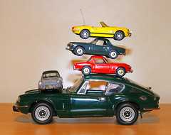 """A Triumph of Stacking ! """"smile on saturday"""" (BIKEPILOT, Thx for + 4,000,000 views) Tags: smileonsaturday stacked atriumphofstacking triumph spitfire gt6 car automobile transport sportscar colours balance model 143 118 green blue yellow red diecast stack"""