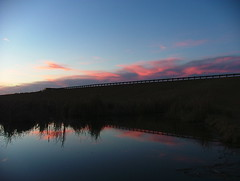 Cloud Reflections (jHc__johart) Tags: oklahoma pond railing cloud roadway serene