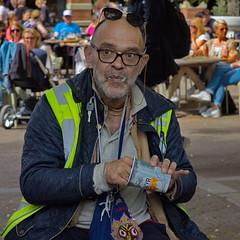 A treat for himself (chipje) Tags: street man treat indulging stadhuisplein leiden netherlands