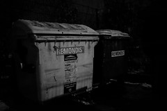 (heinrichj) Tags: trash rubbish garbage waste wasteland wastetales container trashcan monochrome black night fujifilm müll