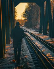 (ErrorByPixel) Tags: walk smc pentaxda 50mm f18 smcpentaxda50mmf18 pentax k5 pentaxk5 errorbypixel winter person railway bridge man sunset cinematic pentaxart