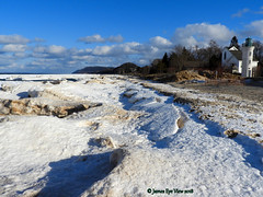 Great Lakes Ice (JamesEyeViewPhotography) Tags: roberthmanninglighthouse greatlakes ice lake michigan sky clouds water snow landscape lighthouse february nature beach jameseyeviewphotography