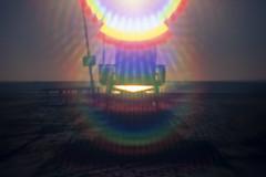 ave 26 (orion + nebula). venice beach, ca. 2016. (eyetwist) Tags: eyetwistkevinballuff eyetwist ave26 venicebeach lifeguard nikon n90s lensbaby fuji velvia 50 rvp nikonn90s fujivelvia50rvp analog analogue ishootfilm ishootfuji emulsion dof focus tilt shift nikkor slide blur losangeles los angeles la angeleno venice beach california hut tower stand sand surf water pacific ocean waves horizon baywatch pacificocean oceanfrontwalk 26thavenue socal seascape star filter orion nebula hama stacked flare spectrum color sunburst 35mm sunset