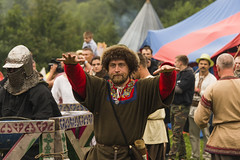 Participant of the festival explained to the audience with gestures (serhiy4) Tags: open medieval people visitors ukrainian ukraine summer lvov show festival event culture cultural public arm helmet steel armour chainmail competition cold charisma character iron knight weaponry knighthood weapon tournament confidence temper joust clothes linen evening boy dress hat fortress ethnic men rest respite gesture hands fingers fur beard