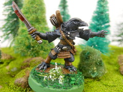 kenku1 (Giantnerdguy) Tags: kenku noname crow rogue thief black blue brown white green flowers dirt sword blood mini miniature reaperminibow armour dd dnd