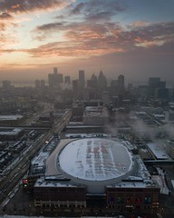 Foggy sunrise over Little Caesar's Arena, home of the Detroit Red Wings and Pistons (benjaminechterling) Tags: detroit motor city motorcity lca little caesars arena redwings pistons drone dji mavic aerial michigan sun sunrise clouds fog foggy sports urban