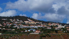 Homes above the airport (Steenjep) Tags: madeira portugal ferie holiday urlaub funchalairport airplane airfield runway truck landscape sky