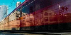 Motion and Reflection (matthew:D) Tags: reflection california city motion red sandiego trolley