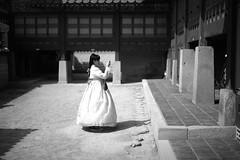 Seoul (Dimitri Tenezakis) Tags: bw nb blackandwhite noiretblanc seoul palace gyeongbokgung girl hanbok dress traditionaldress light architecture street streetphotography city urban