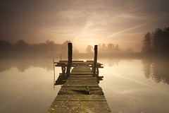 The lonely pier at the lake (seledam) Tags: sunset sunrise lake pier water sky cloud dust cold nature