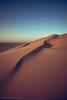DESERT CURVES (Paterdimakis) Tags: desert sand dune hill nature arabia qatar landscape sky light shape curve shadow blue fuji fine art