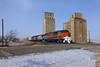Passing through Merricourt (chief_huddleston) Tags: dmvw northdakota nd 5408 3145 6949 train railroad grain sundog elevator