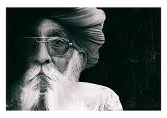 a portrait from rajasthan (handheld-films) Tags: india indian portrait portraiture people faces closeup man men male old elderly rajasthan beard bearded blackandwhite monochrome isolated blackbackground subcontinent travel individual