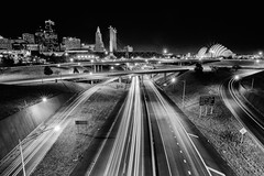 The Hustle (KC Mike Day) Tags: highway monochrome exposure long white black kansascity missouri kansascitymissouri kcmo kansas downtown cityscape trails light starbursts signs architecture midwest