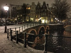 Amsterdam by Night (laurahilhorst) Tags: amsterdam city iamsterdam adam lights nightlights citylife cities canals canal winter snow snowing december amsterdamcity citylights lighting houses architecture capital netherlands nikond5000 nikonphotography cityphotography colors black water trees walking citytour
