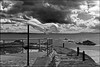 Laundry Day - Pittenween, Scotland (TravelsWithDan) Tags: bw blackandwhite seascape clouds ocean northsea pittenween scotland laundry dryingonaline laundrybytheocean candid canong3x strongwind outdoors city village oceanfront ngc