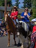 Riding Into Town (Scott 97006) Tags: woman females ladies horse ride parade sunny