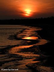 Sunrise on Ice (JamesEyeViewPhotography) Tags: sunrise lakemichigan lake michigan water waves ice greatlakes sky clouds winter january nature landscape beach northernmichigan sleepingbeardunesnationallakeshore jameseyeviewphotography
