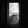 Step Into the Light (colinpoe) Tags: stone cloisters blackandwhite rolleiflex mediumformat 6x6 door portal rolleiflexautomat palisades tlr rolleiflexautomatk4a kodakfilm winter bw branches tmax100 120