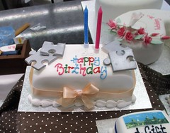 For jigsaw lovers (pefkosmad) Tags: cake decorated window oxford oxfordshire fantasy england uk market coveredmarket cakedecorating icing jigsaw puzzle novelty birthdaycake