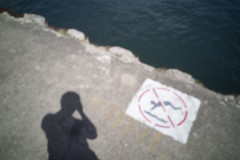 No Swimming (Sean Anderson Media) Tags: pinhole pinholelens pinholephotography lofi lofiphotography homemadelens faded lakemichigan lakeside chicago sonya7s bodycap water summer noswimming concrete blurry outoffocus waterside lake shadow vintage retro sign photographer