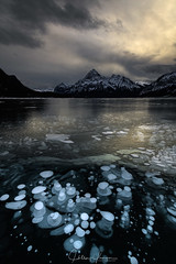 Collision of Worlds (hillsee) Tags: mountain canadianrockies abrahamlake icebubbles methane ice light evening sunset moody drama reflections landscape nature winter snow clouds