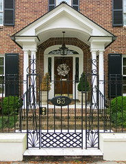 Charleston modern: 63 East Bay Street (1954), Charleston, SC (Spencer Means) Tags: architecture house facade façade portico door entrance front brick brickwork porch lantern light wreath cotton fence gate iron ironwork 63 east bay street charleston sc southcarolina steps easter