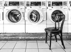 Speed Queen Clean Machines (DobingDesign) Tags: laundry washingmachine blackandwhite tiledfloor woodenchair launderette laundrette lines circles machines wash laundromat automatic glassdoors numbers signage text 350 doorless coinoperated coinslot emptychair