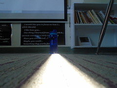 DSC00550 (classroomcamera) Tags: school campus classroom floor ground carpet rug light bright white blue plastic water bottle poster low leg chair shelves shelf books follow pathway leading line lines path